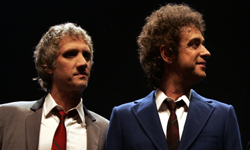 Soda Stereo band members from left to right, Charly Alberti, Gustavo Cerati and Zeta Bosio pose for a picture during a news conference in Buenos Aires, Thursday, Sept. 20 2007. The Argentine band will begin touring in October after 10 years of separation, reediting the old successes that turned them into one the most influential rock bands of Latin America in the last the decade.  (AP Photo/Natacha Pisarenko)